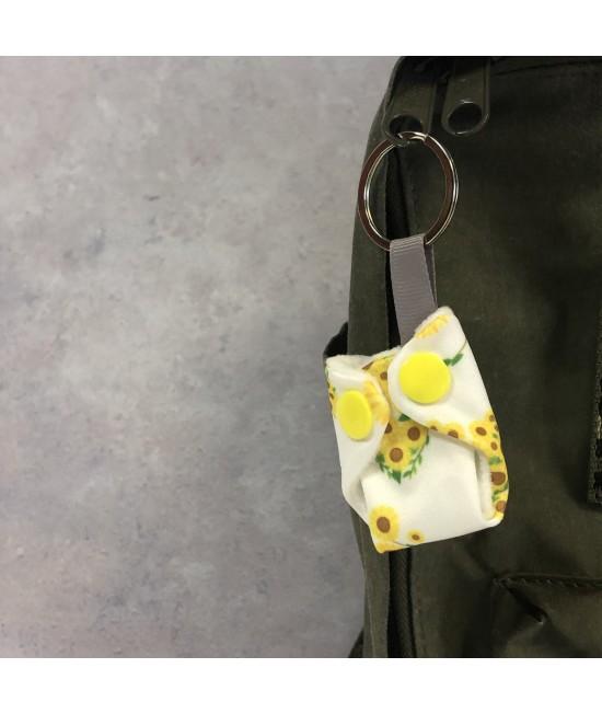 Breloc Baba+Boo în formă de scutec textil Sunflowers
